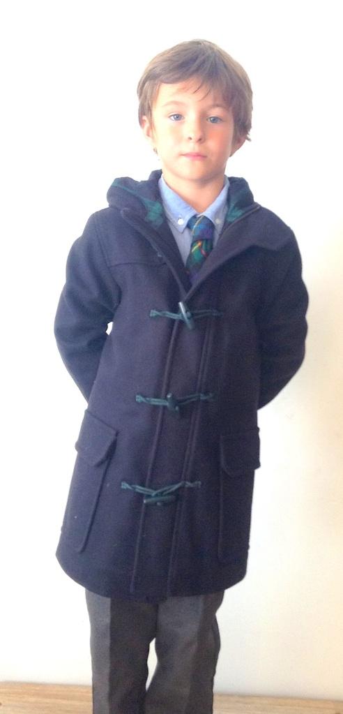 Camisa oxford de mango kids 17'99 euros, corbata de Nicoli, pantalon de uniforme de carrefour